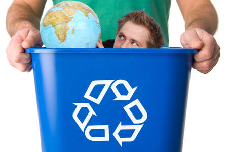 Man with globe in garbage for recycling photo