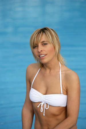 Blond woman in white bikini photo