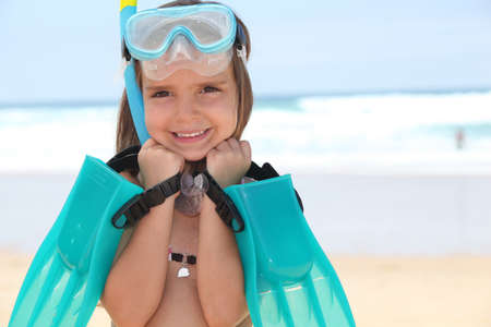 waist deep: little girl with flippers, mask and snorkel