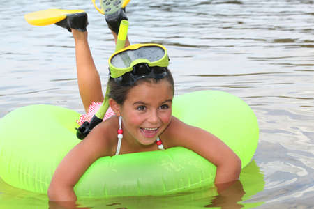 Young girl learning to snorkel photo