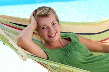 young blonde woman in a hammock photo