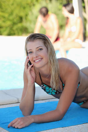 dampen: sunning, by pool Stock Photo