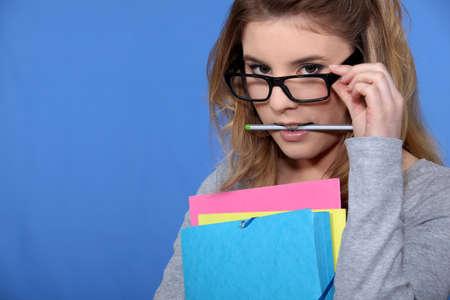 geeky: Geeky looking woman with folders