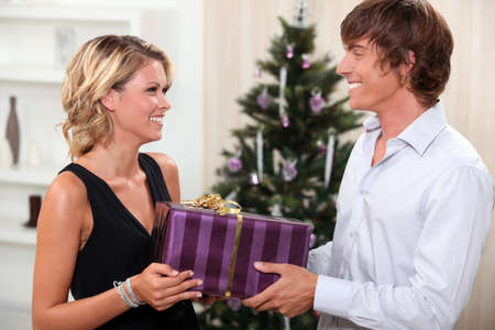 Couple with a Christmas present Standard-Bild