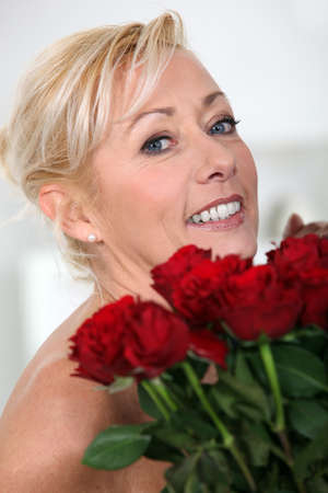 wooing: Woman with a bunch of red roses