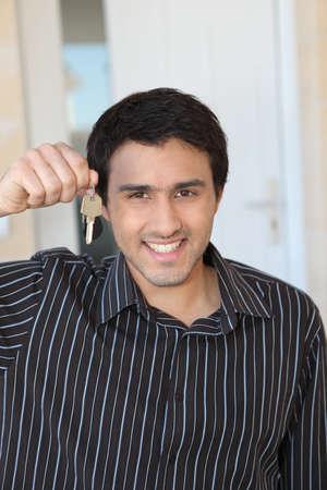 first time buyer: Man holding a doorkey