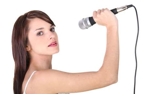 kareoke: young girl holding microphone