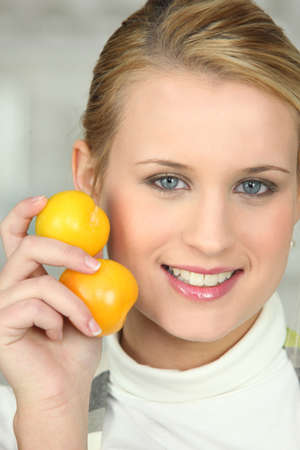 skivvy: Blonde woman holding yellow plums