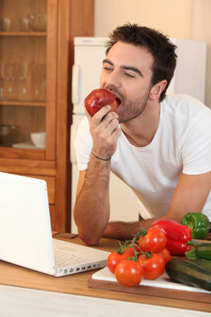 Man biting into an apple photo