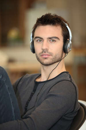 Single man with headphones photo