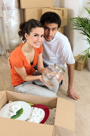 Young couple in their new apartment Stock Photo - 12529444