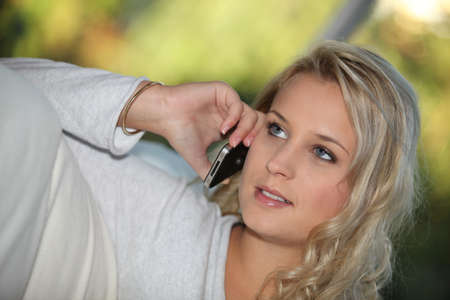 16 17: Young woman on a cellphone Stock Photo