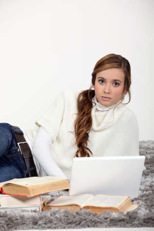 highlighted hair: Young woman studying for exams Stock Photo