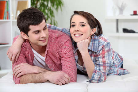 heterosexual couples: young couple relaxing on the couch Stock Photo