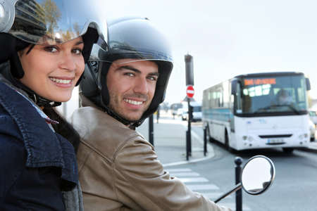 Couple on scooter in a crossroad photo