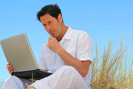 Man working on the beach