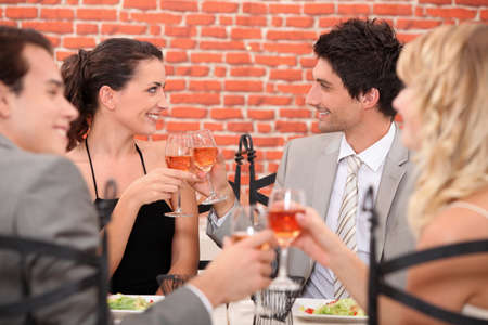 romantic foursome at restaurant Stock Photo