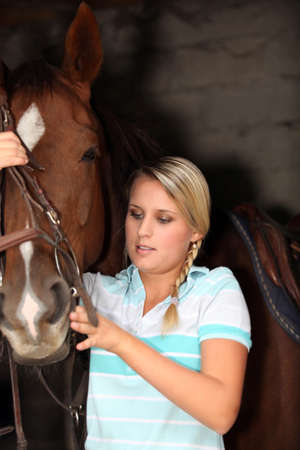 juvenile blonde with horse photo