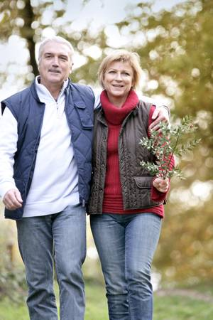 a year older: Couple taking a walk through woodland