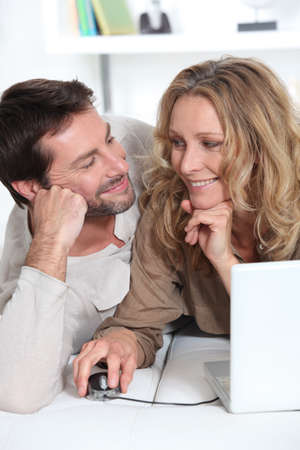 35 40 years: Couple on laptop looking into each other