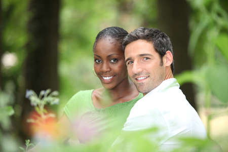 interracial relationships: Interracial couple in a park  Stock Photo