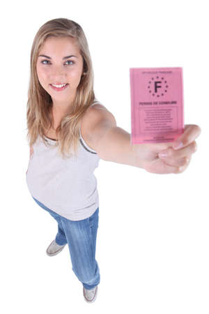 17: Young person showing driving licence