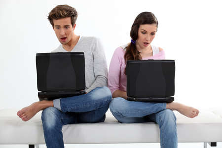 Shocked people in front of laptops photo
