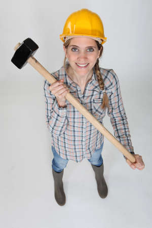 chirpy: Tradeswoman holding a mallet Stock Photo