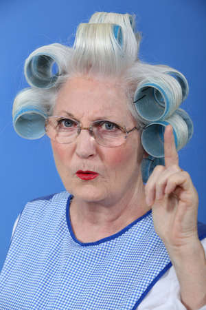 curlers: Old woman waving her finger in disapproval