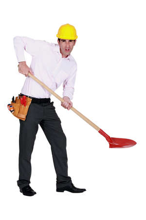 abhorrence: Protesting engineer using a spade