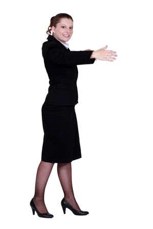 Woman gesturing a hug Stock Photo - 12528942