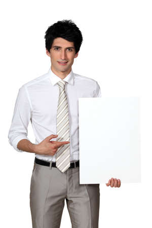 Businessman with blank poster Stock Photo