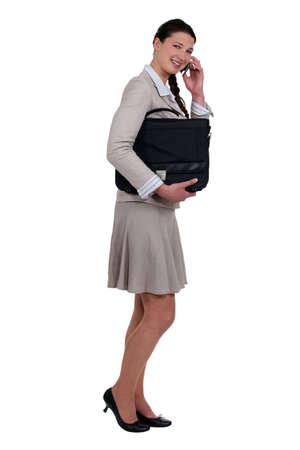 Walking businesswoman on the phone Stock Photo - 12528941