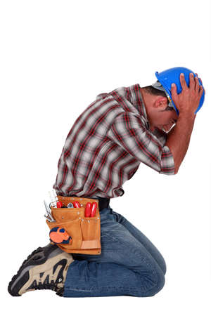furious craftsman on his knees photo