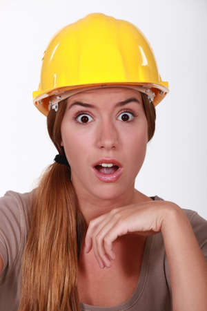 gaping: Portrait of an astonished tradeswoman Stock Photo
