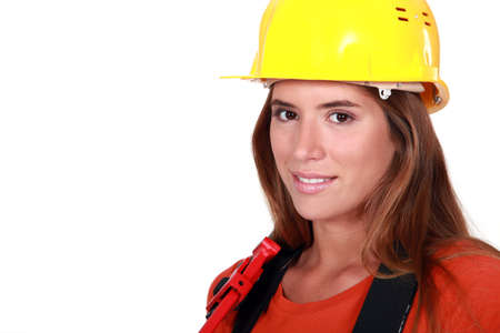 engineer's: Attractive female worker holding wrench