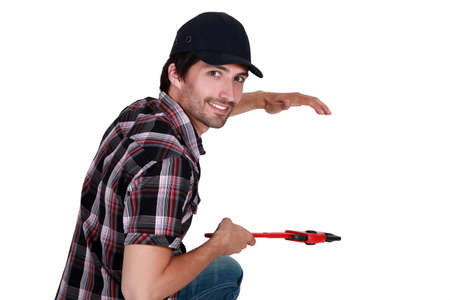 Tradesman fixing an invisible object photo