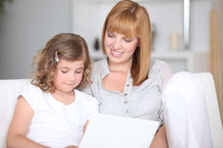 Mother and daughter using a laptop Stock Photo - 12529861