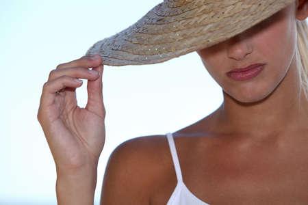long weekend: Blond woman wearing straw hat Stock Photo