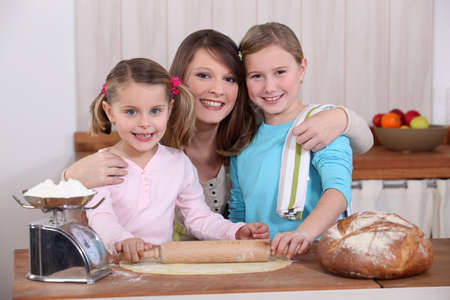 kneading: Mother and daughters making bread Stock Photo