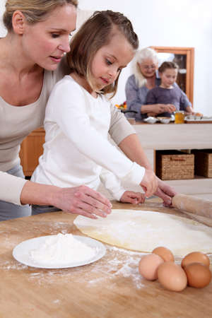mothers and daughter cooking together photo