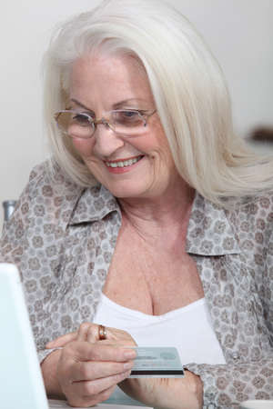 savvy: Elderly woman buying on-line Stock Photo