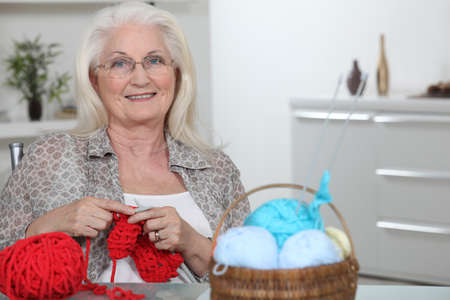 senior woman knitting photo