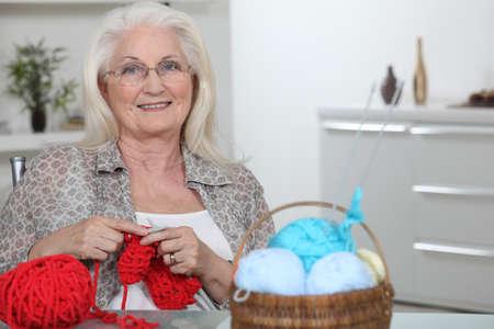 grandmothers: senior woman knitting
