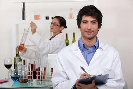 pharmacy technician: A couple in a laboratory  Stock Photo