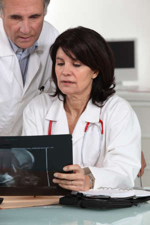 Doctors examining x-ray photo