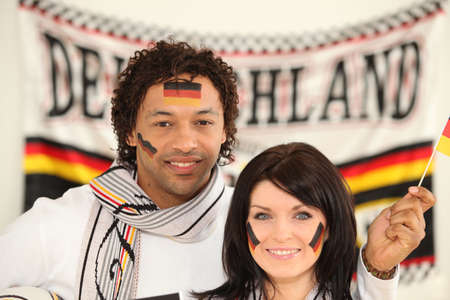 nationalists: Couple supporting the German football team Stock Photo