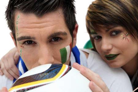 ballgame: couple of Italian soccer supporters Stock Photo