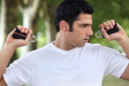 Man performing wrist exercise Stock Photo - 12529663