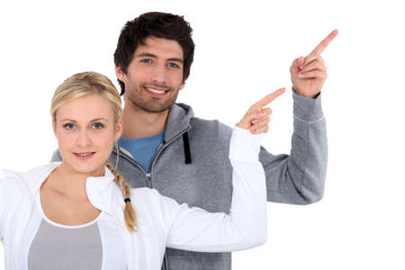 trajectory: man and woman pointing with finger Stock Photo